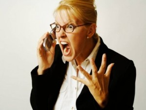 angry-businesswoman-on-phone-M30924
